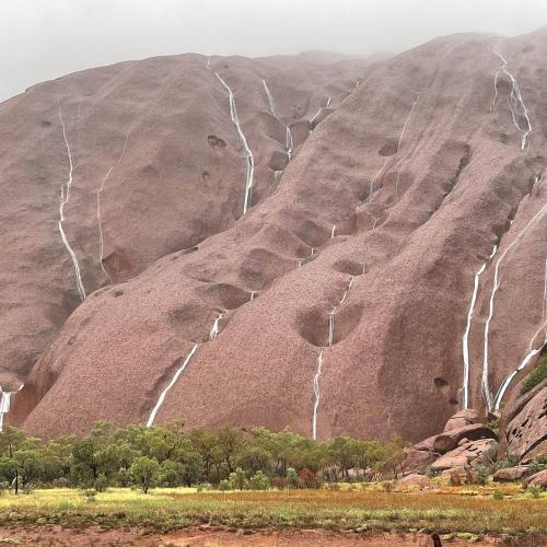 Mother Nature Brings Waterfalls On Uluru